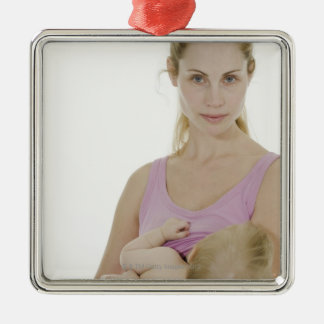 Mother breastfeeding her baby. 2 Silver-Colored square decoration