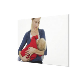 Mother breastfeeding her baby. canvas print