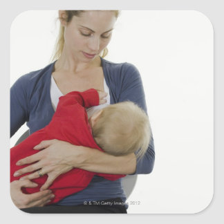 Mother breastfeeding her baby. square sticker