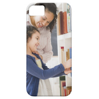 Mother helping daughter choose book on shelf iPhone 5 cover