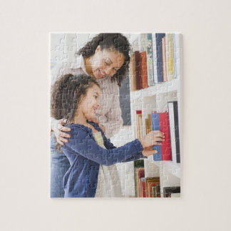 Mother helping daughter choose book on shelf jigsaw puzzle