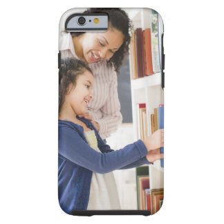 Mother helping daughter choose book on shelf tough iPhone 6 case