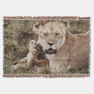 Mother lion sitting with her cub throw blanket