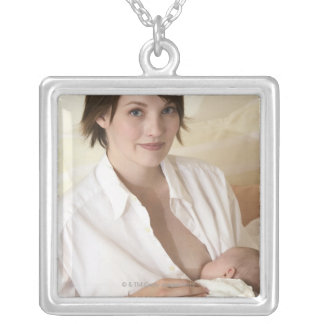 Mother nursing baby silver plated necklace