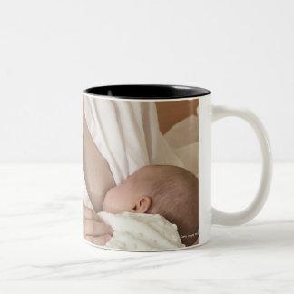 Mother nursing baby Two-Tone mug