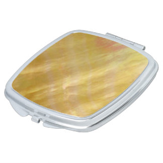 Mother of pearl tones gold mirror for makeup