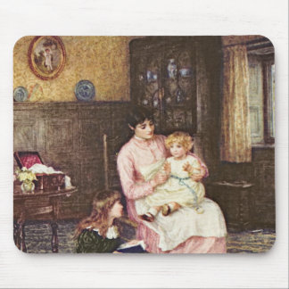 Mother playing with children in an interior mouse mat