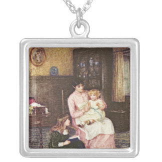 Mother playing with children in an interior silver plated necklace