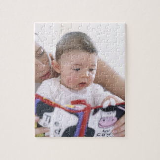 Mother reading to baby boy. Faces of a mother Jigsaw Puzzle