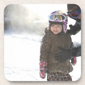 Mother Teaching Daughter To Snowboard Coaster