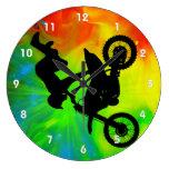Motocross in a Solar Flareup Wall Clocks