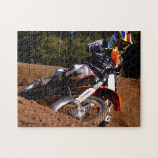 Motocross rider racing hard through the corner jigsaw puzzle
