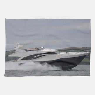 Motor cruiser at speed. tea towel