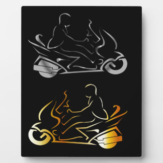 Motorbike with a person wearing helmet display plaque
