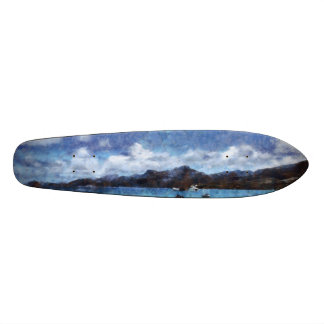 Mountain and boats on the beach skate boards