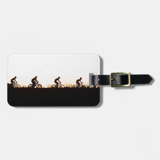 Mountain Bike Riders Make Their Way Over The Dam Luggage Tag