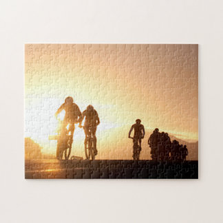 Mountain Bike Riders Make Their Way Over The Top Jigsaw Puzzle