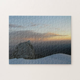 Mountain rock in winter and the sunset sky puzzle