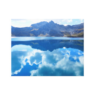 Mountains And Clouds Reflection On A Lake Canvas Print