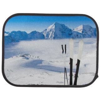 Mountains and ski equipment car mat