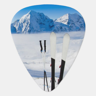 Mountains and ski equipment guitar pick
