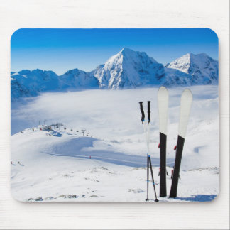 Mountains and ski equipment mouse mat