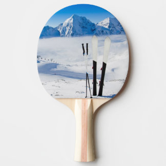 Mountains and ski equipment ping pong paddle