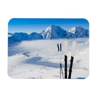 Mountains and ski equipment rectangular photo magnet