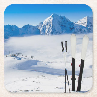 Mountains and ski equipment square paper coaster