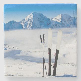 Mountains and ski equipment stone beverage coaster