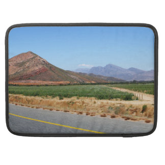 Mountains and Vineyards by a road in South Africa MacBook Pro Sleeves