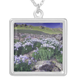 Mountains and wildflowers in alpine meadow, square pendant necklace