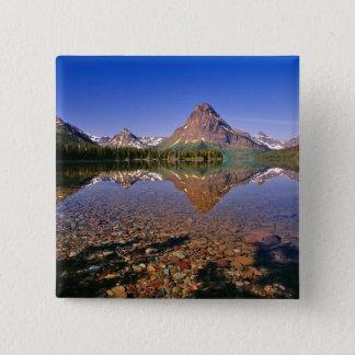 Mountains reflect into calm Two Medicine Lake in 15 Cm Square Badge