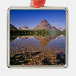 Mountains reflect into calm Two Medicine Lake in Square Metal Christmas Ornament