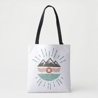 Mountains, sun and ocean tote bag