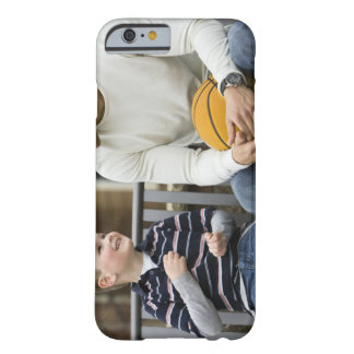MR Man (age 25) and boy (age 6) sitting on park Barely There iPhone 6 Case