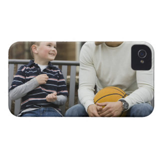 MR Man (age 25) and boy (age 6) sitting on park iPhone 4 Case