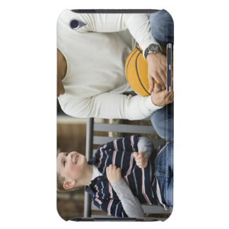 MR Man (age 25) and boy (age 6) sitting on park iPod Touch Cover