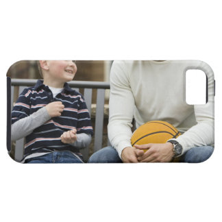 MR Man (age 25) and boy (age 6) sitting on park Tough iPhone 5 Case
