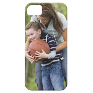 MR mother (age 26) playing basketball with son Case For The iPhone 5