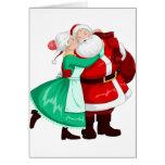 Mrs Claus Kisses Santa On Cheek And Hugs Greeting Card