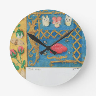 Ms 134 Illuminated letter `A' and side border of f Wallclock