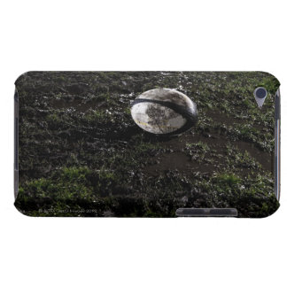 Muddy rugby ball sitting on a chewed up grass barely there iPod case