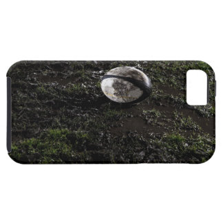 Muddy rugby ball sitting on a chewed up grass iPhone 5 case