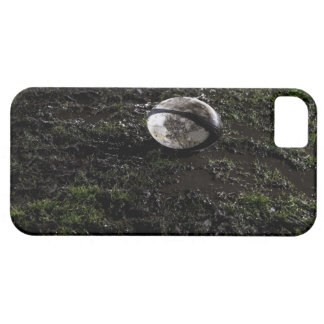 Muddy rugby ball sitting on a chewed up grass iPhone 5 cover