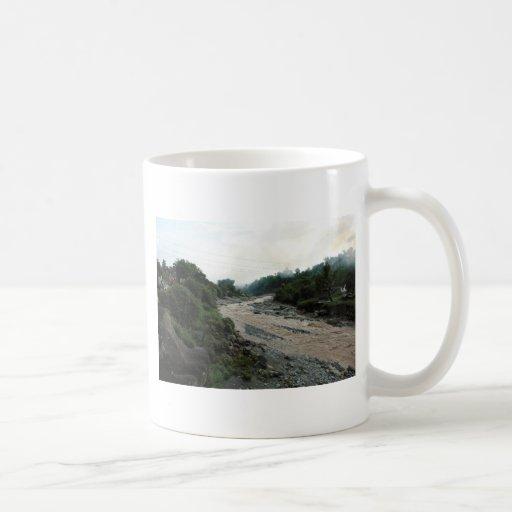 Muddy stream and smoke in Himalayas after rain Mugs