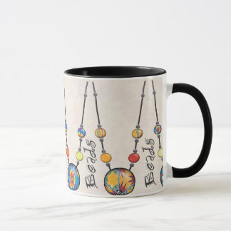 Mug with brightly colored beads