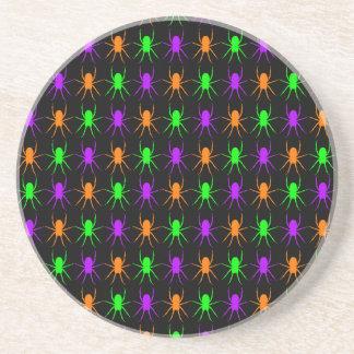 Multi bright spiders on black coaster