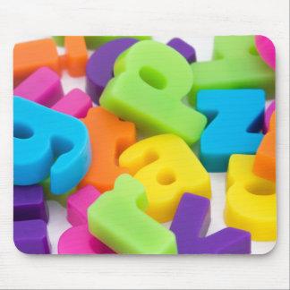 multi coloured alphabet letters background mouse m mouse mat