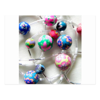 multi coloured beaded necklace postcard